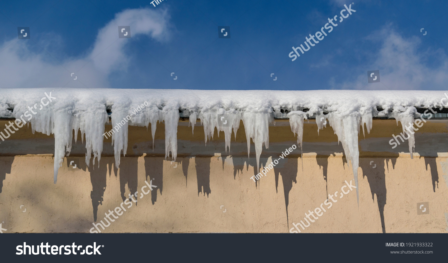 stock-photo-snow-and-ice-icicles-on-the-