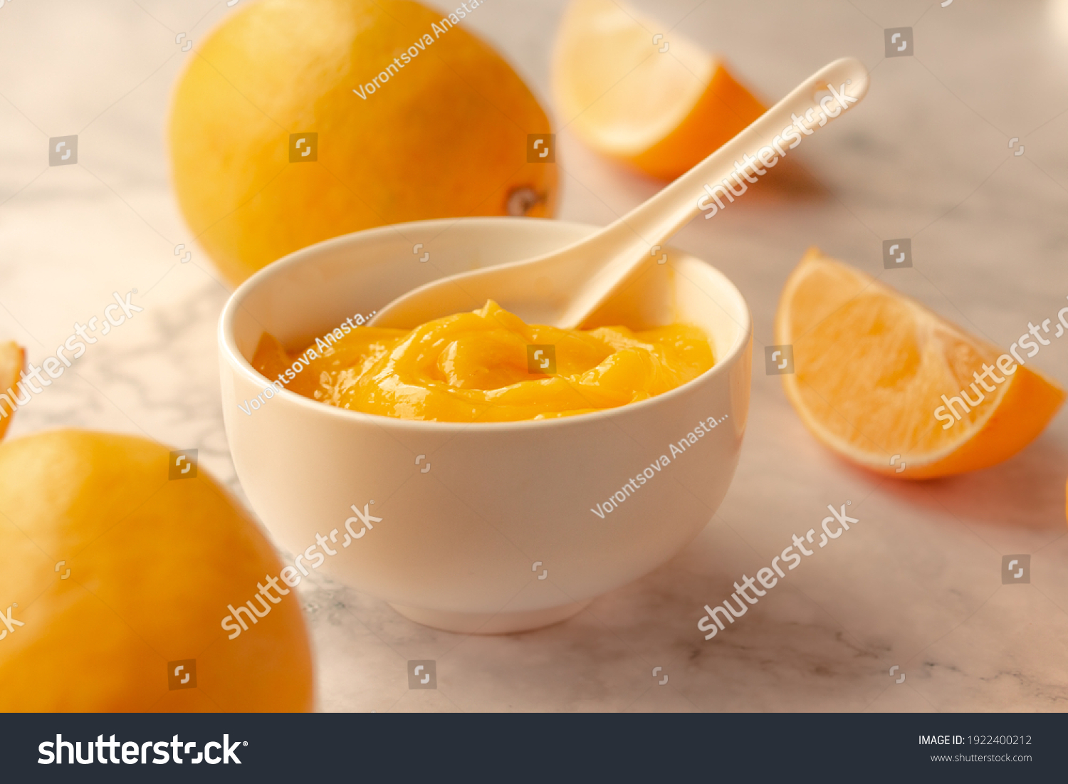 Homemade fresh pudding or tangy lemon curd in a white bowl.Selective focus. #1922400212