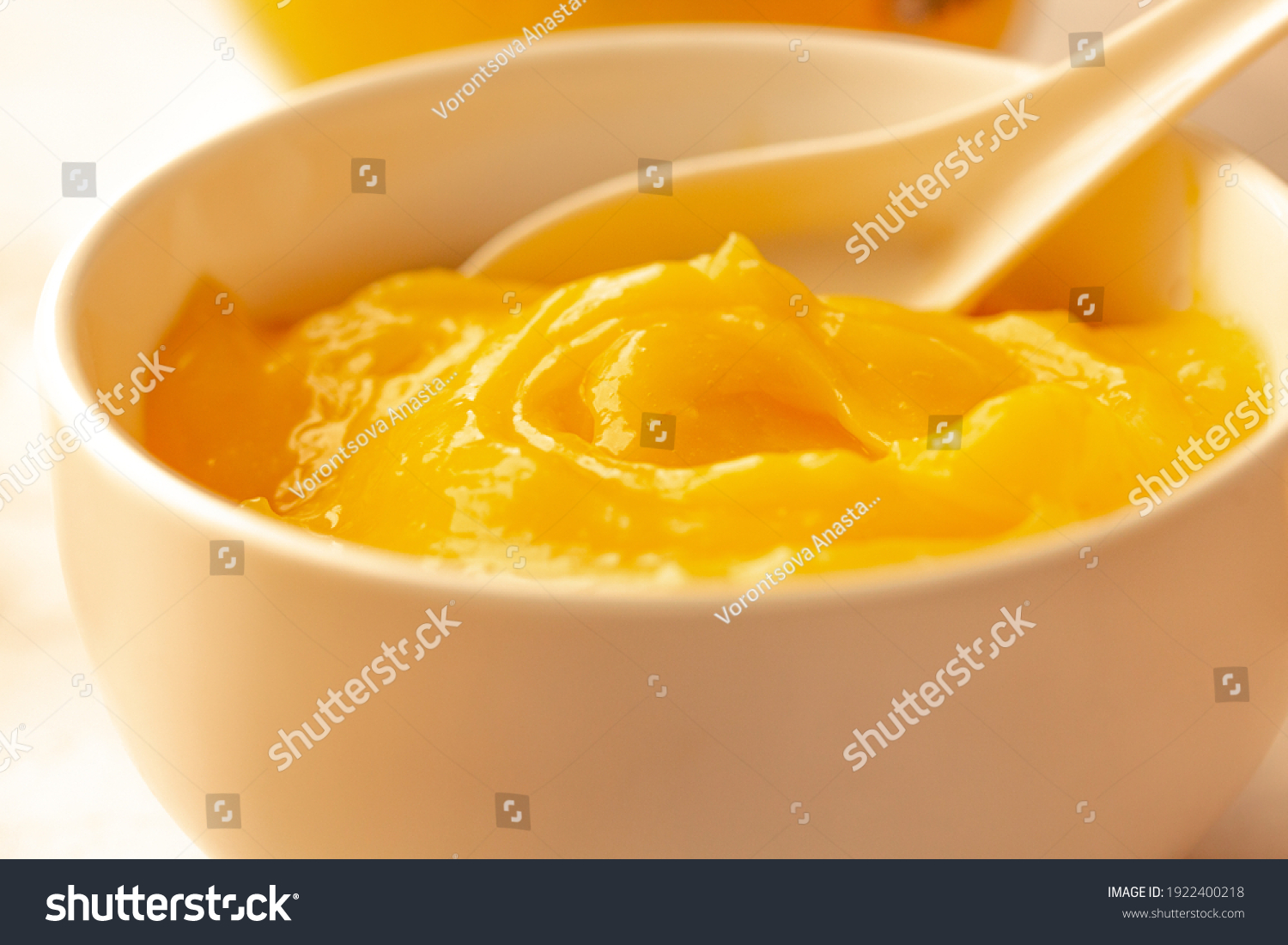Homemade fresh pudding or tangy lemon curd in a white bowl.Selective focus. #1922400218