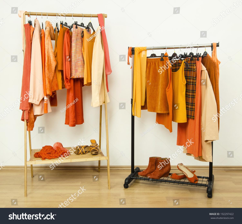 Dressing Closet Orange Clothes Arranged On Stock Photo ...