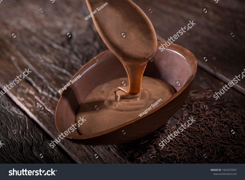Chocolate Easter egg stuffed with chocolate sauce. #1923237047