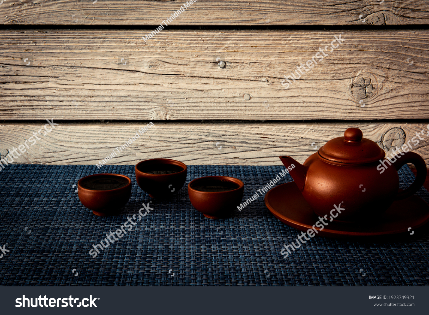 stock-photo-clay-teapot-and-three-tea-bo