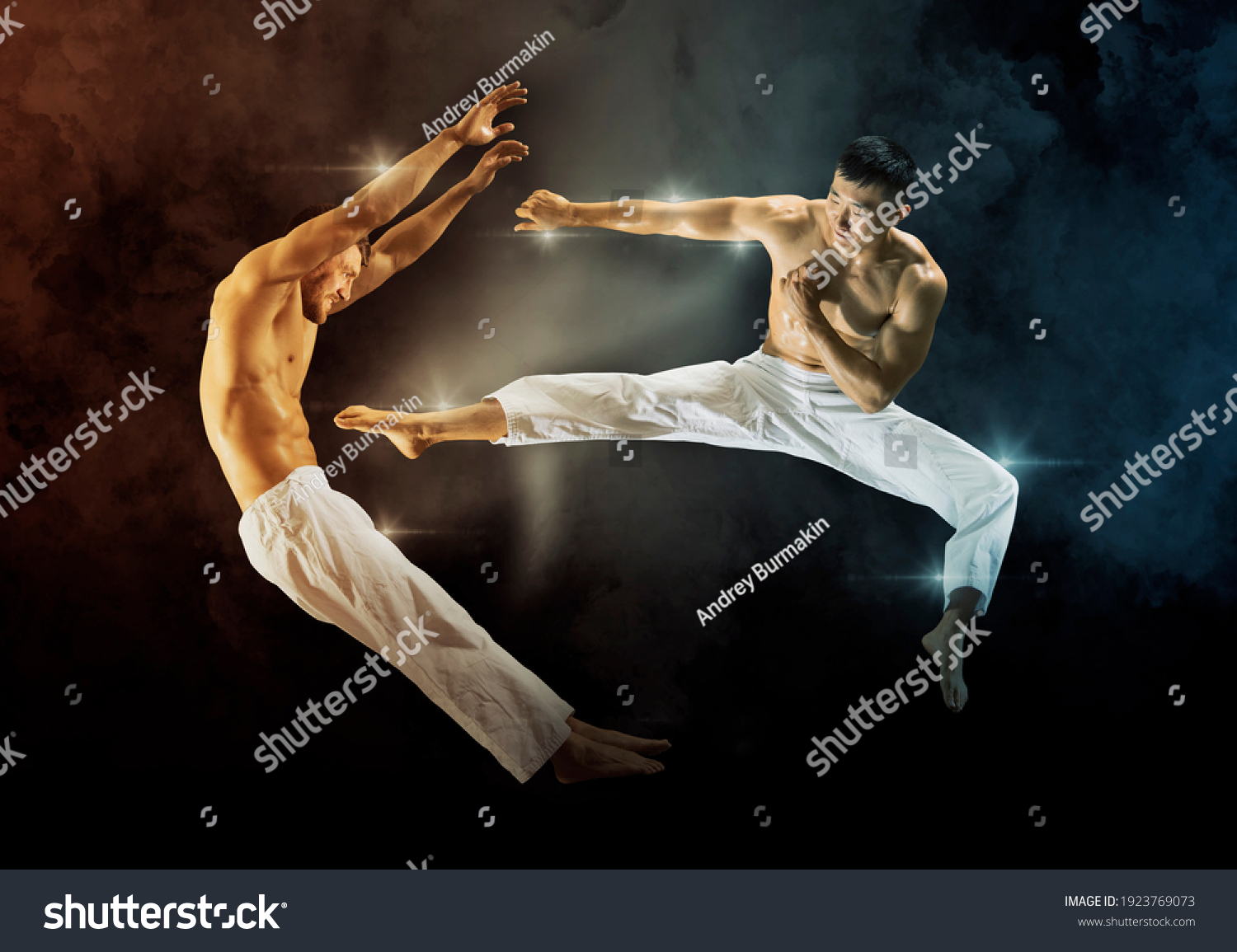 Two martial arts masters, karate practice. On black background #1923769073