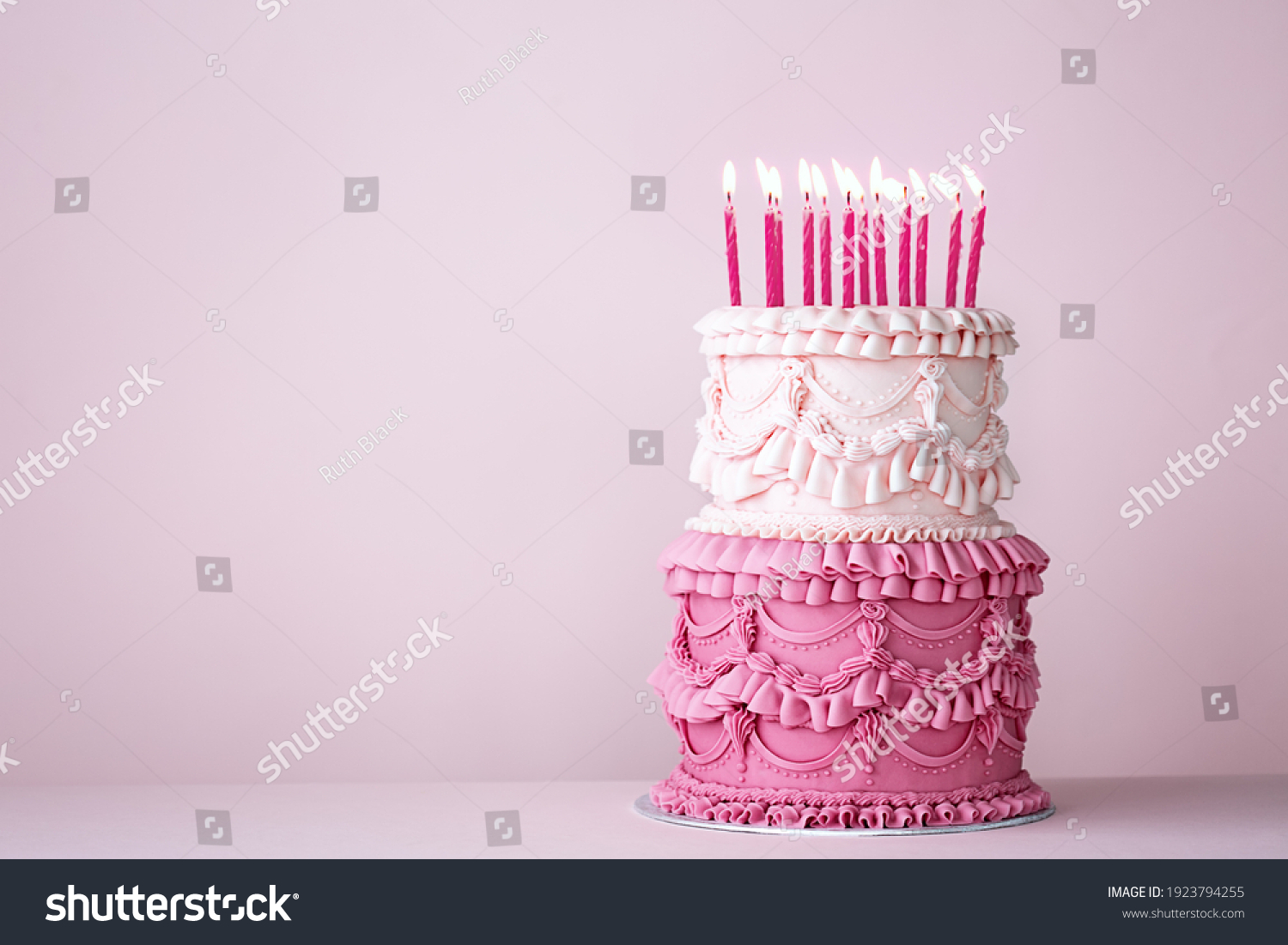 Ornate vintage buttercream birthday cake with buttercream ruffles and frills #1923794255