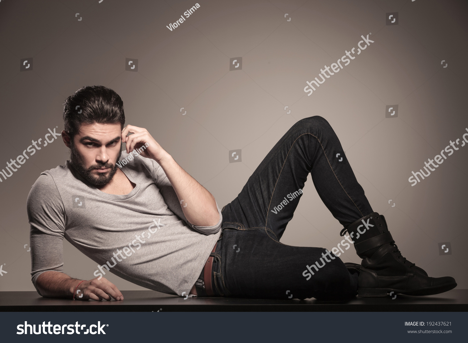 Side view bearded young man lying stock photo 192437621 for Down to the floor