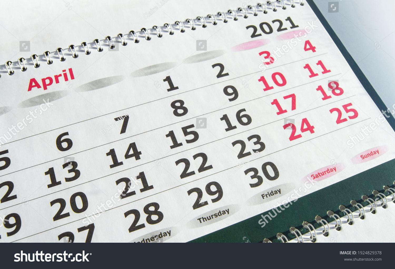 April 2021 paper calendar planner with spiral, close-up. #1924829378