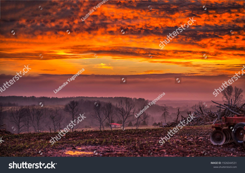 Foggy field at sunset landscape #1926044531