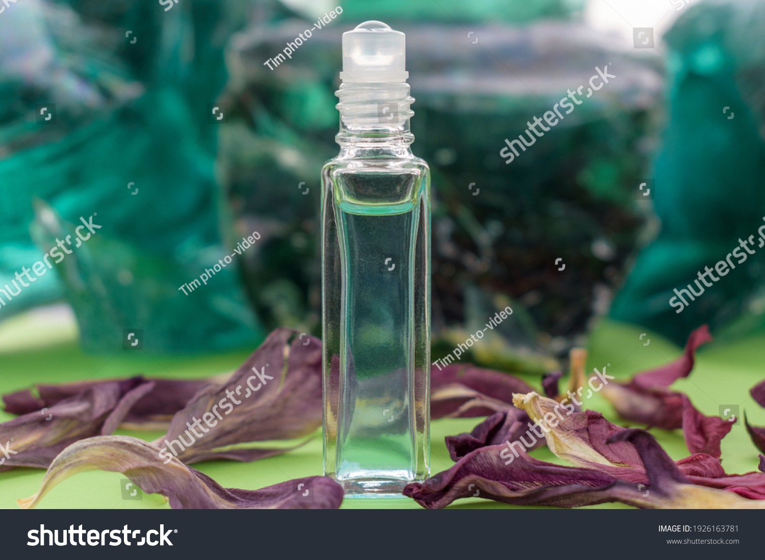 stock-photo-glass-bottle-with-perfume-ba
