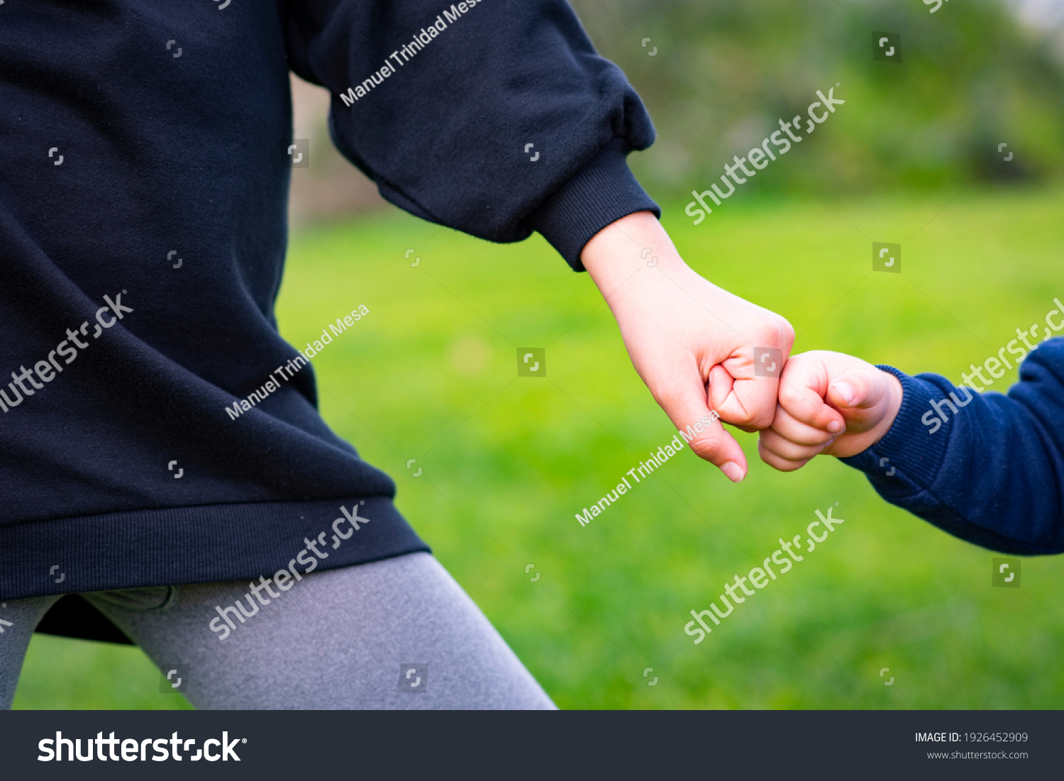 stock-photo-two-boys-hitting-their-fists