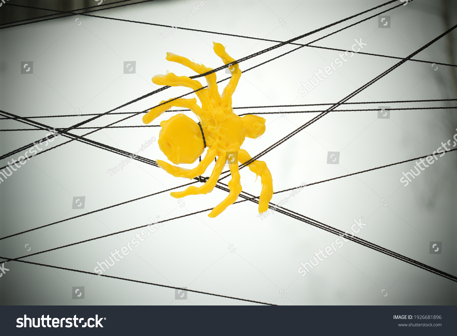 stock-photo-yellow-plastic-spider-cobweb