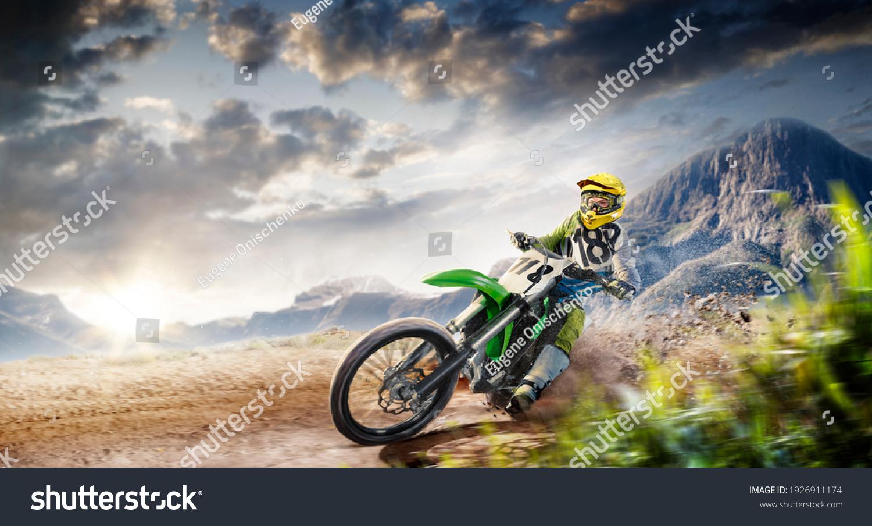 Professional enduro bike rider on action. Turn on sand terrain. #1926911174