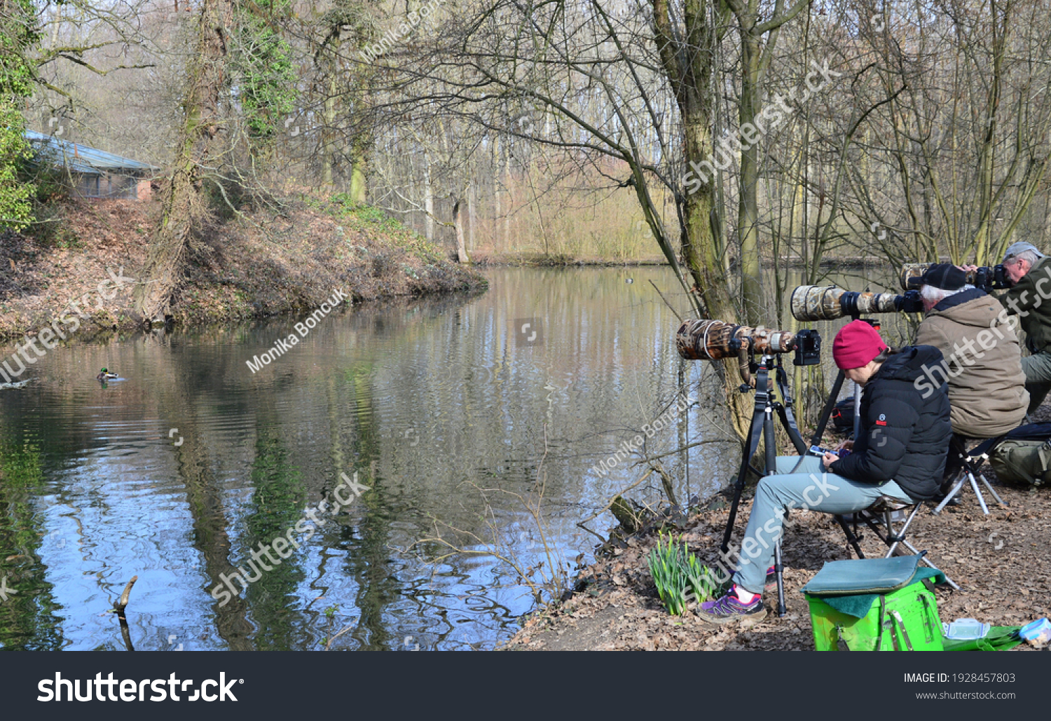 Mönchengladbach,Germany,March 2021, a group of birdwatchers in a park
