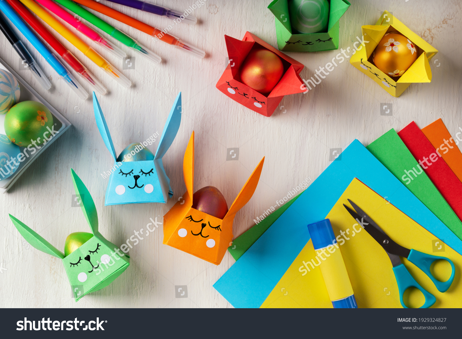 DIY paper crafts for the Easter holiday. Origami paper Easter bunny - egg basket for Easter greetings. Hobbies at home. Self-employment and needlework. DIY concept. Step by step instruction #1929324827