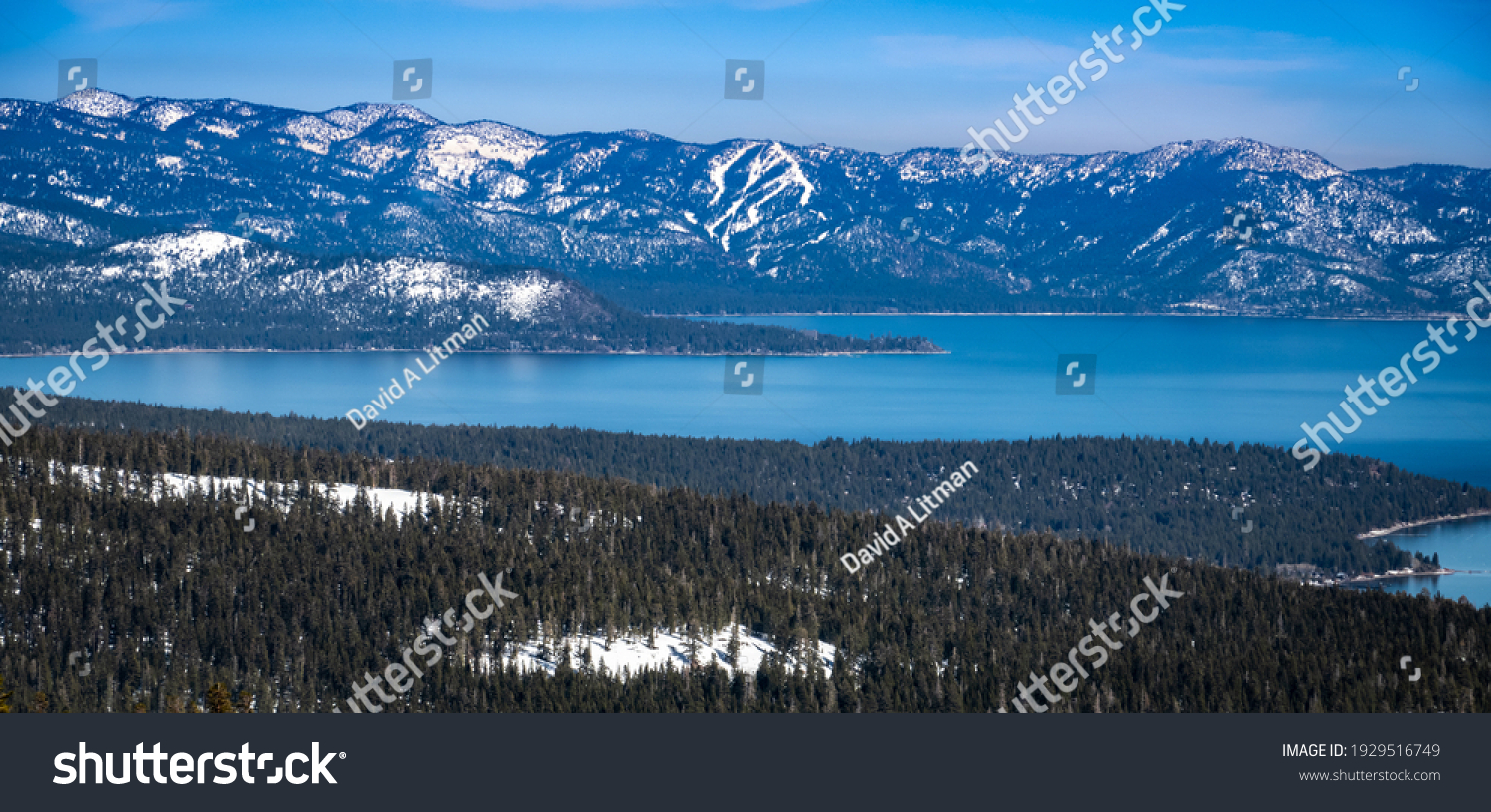 Scenic view of Lake Tahoe, in the Sierra Nevada Mountain Range of California, as shot from Alpine Meadows, with the runs Diamond Peak ski resort in the background.
