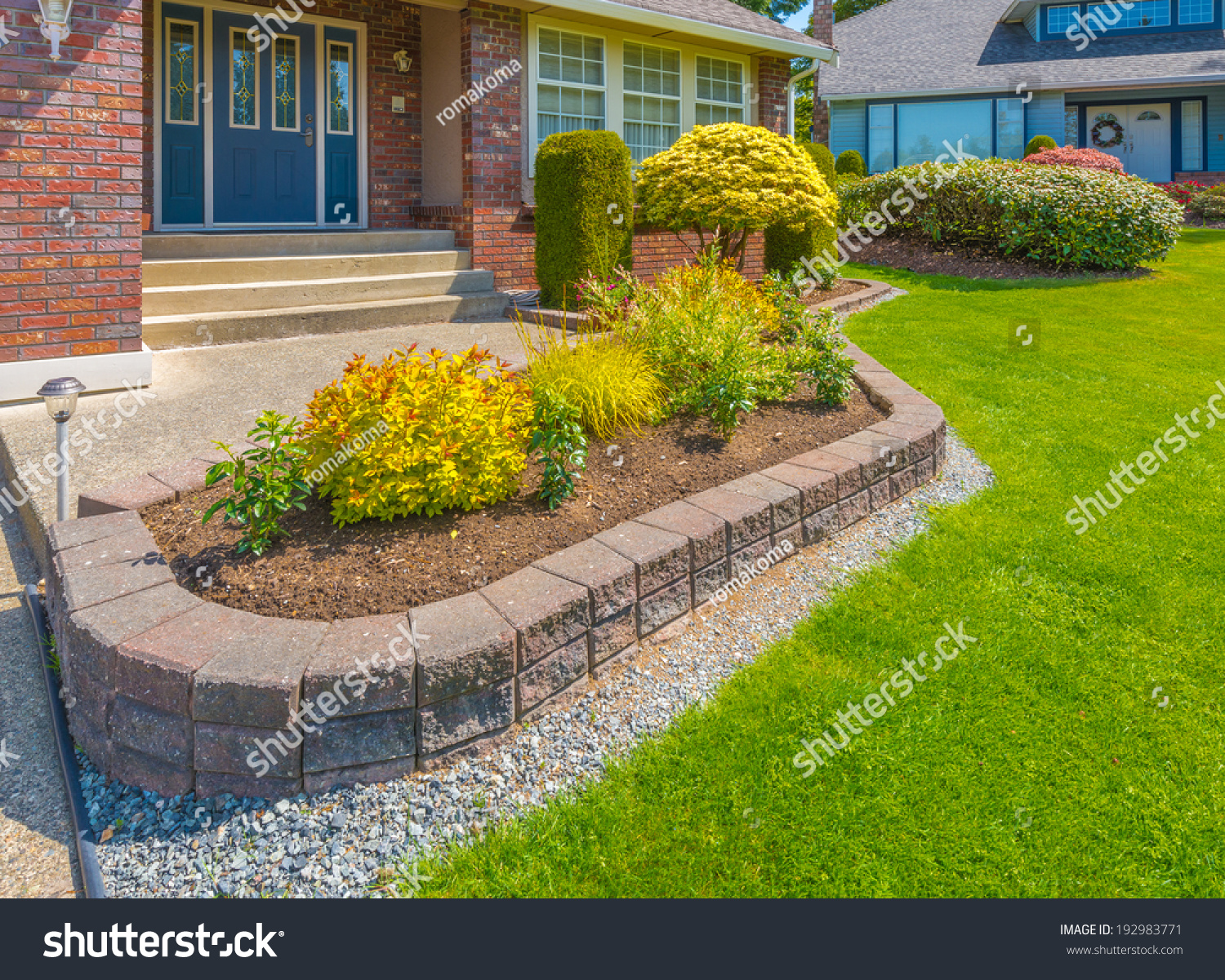 Decorative Stones For Flower Beds Nicely Decorated Colorful Flowerbed Front Yard Stock Photo