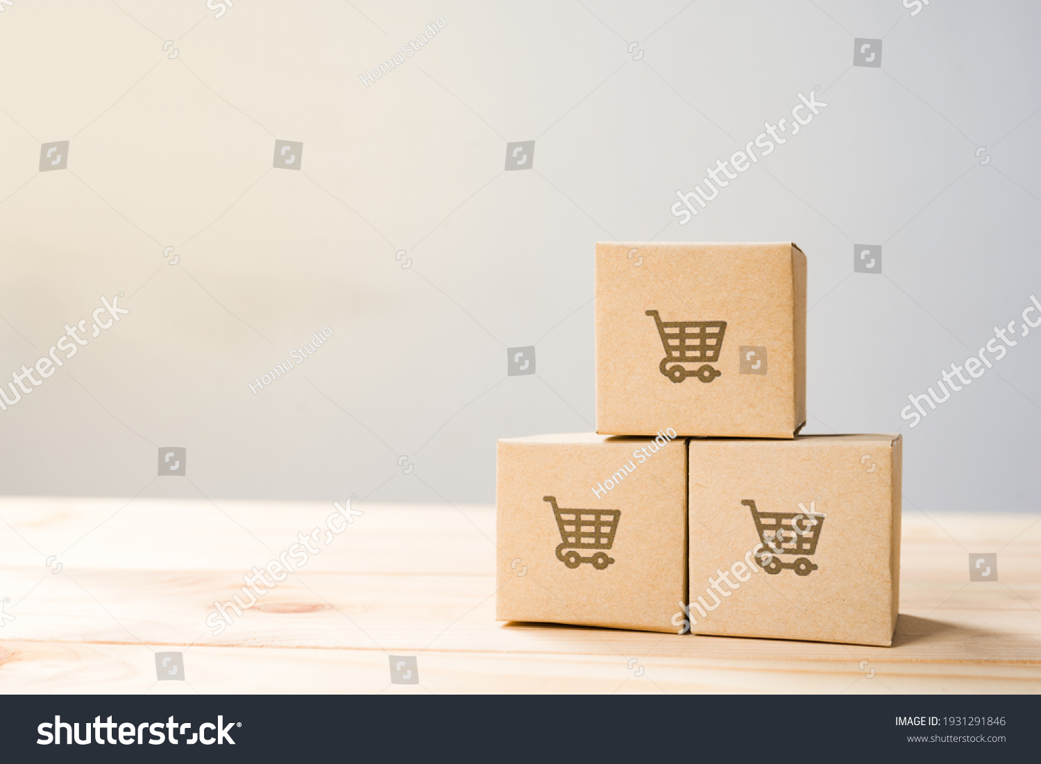 Online shopping ,Shopping cart logo on boxes on wooden table. #1931291846