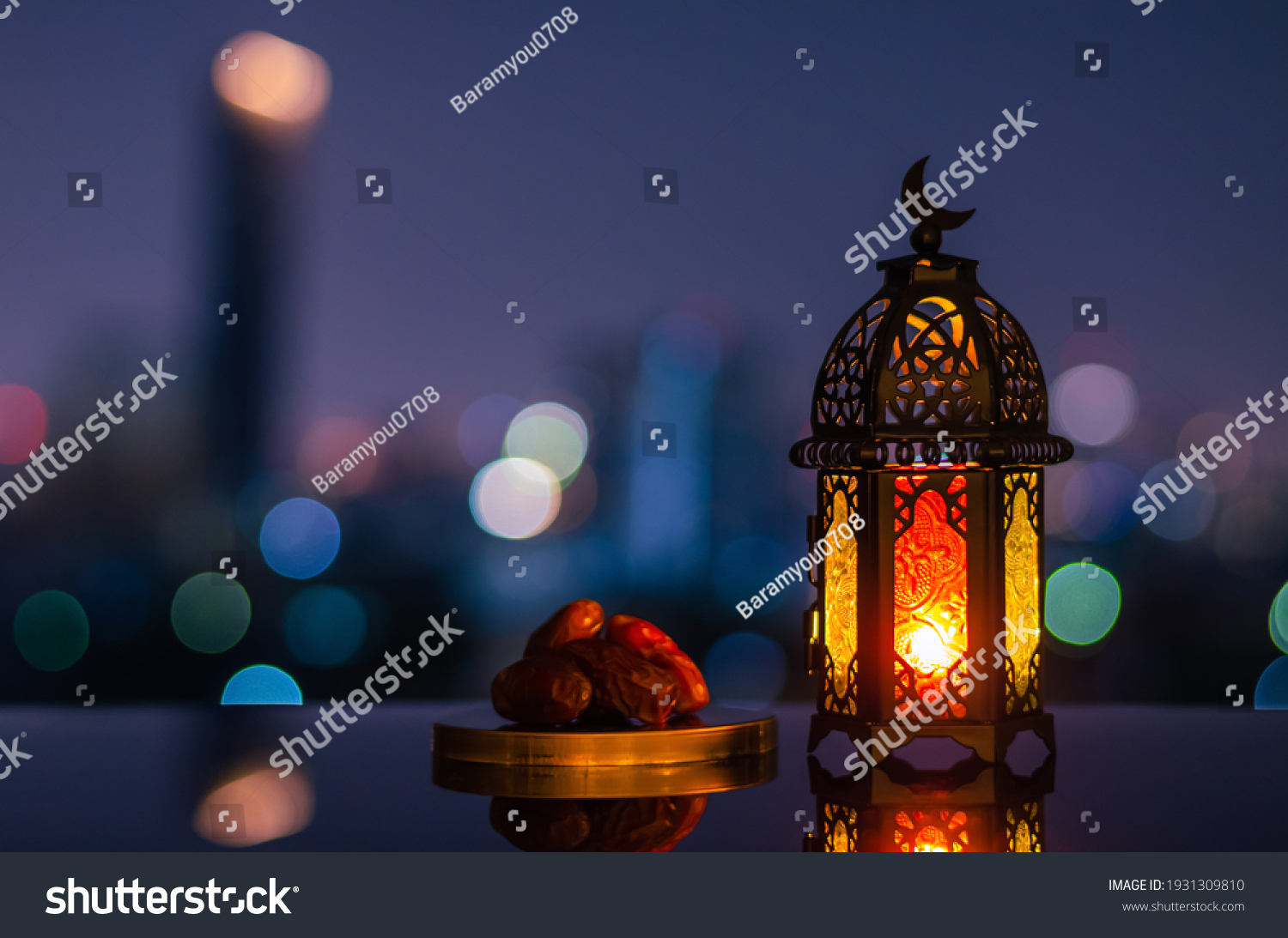 Lantern that have moon symbol on top and small plate of dates fruit with night sky and city bokeh light background for the Muslim feast of the holy month of Ramadan Kareem. #1931309810