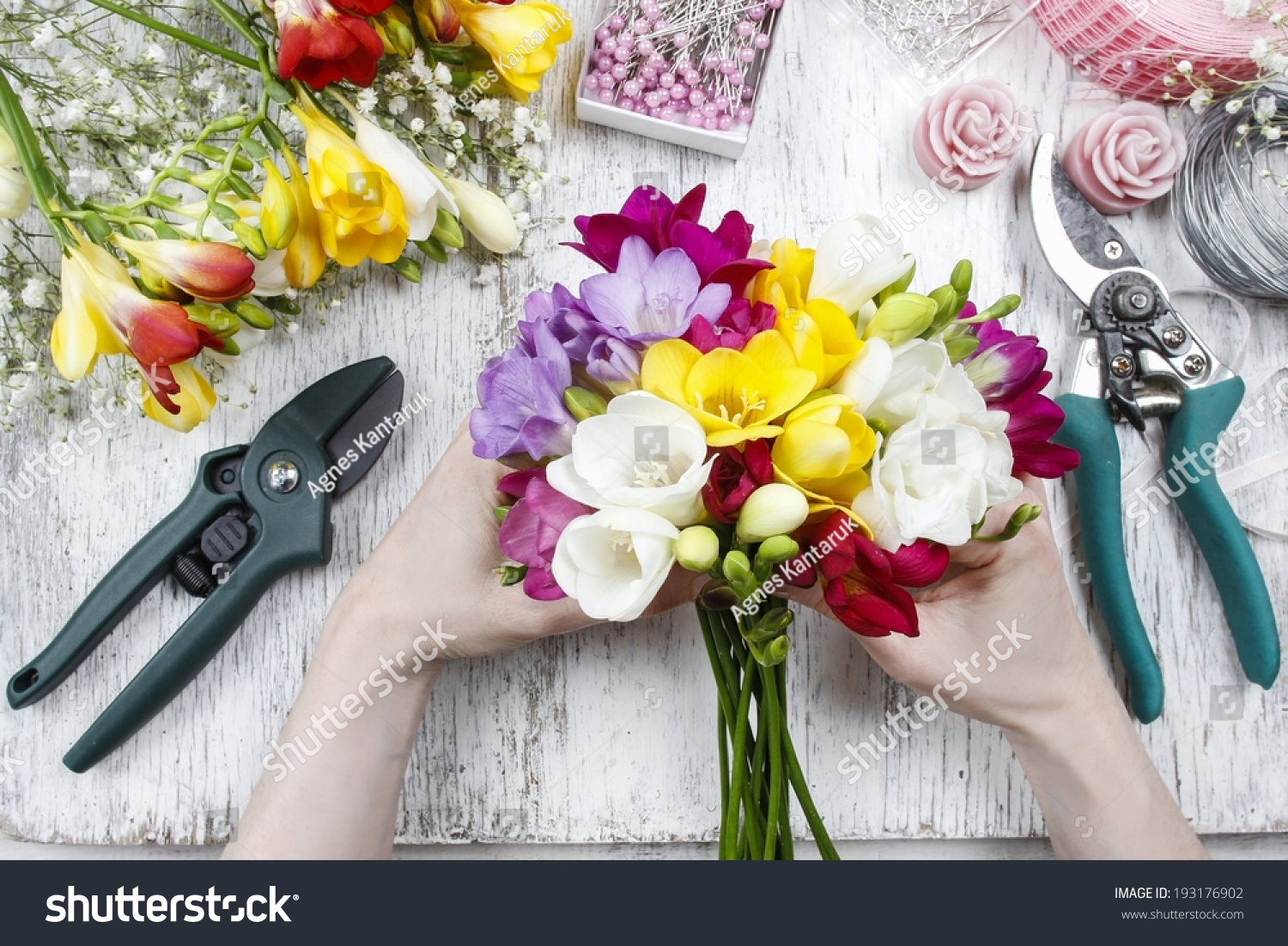 Florist at work woman making bouquet of freesia flowers ez canvas woman making bouquet of freesia flowers ez canvas izmirmasajfo