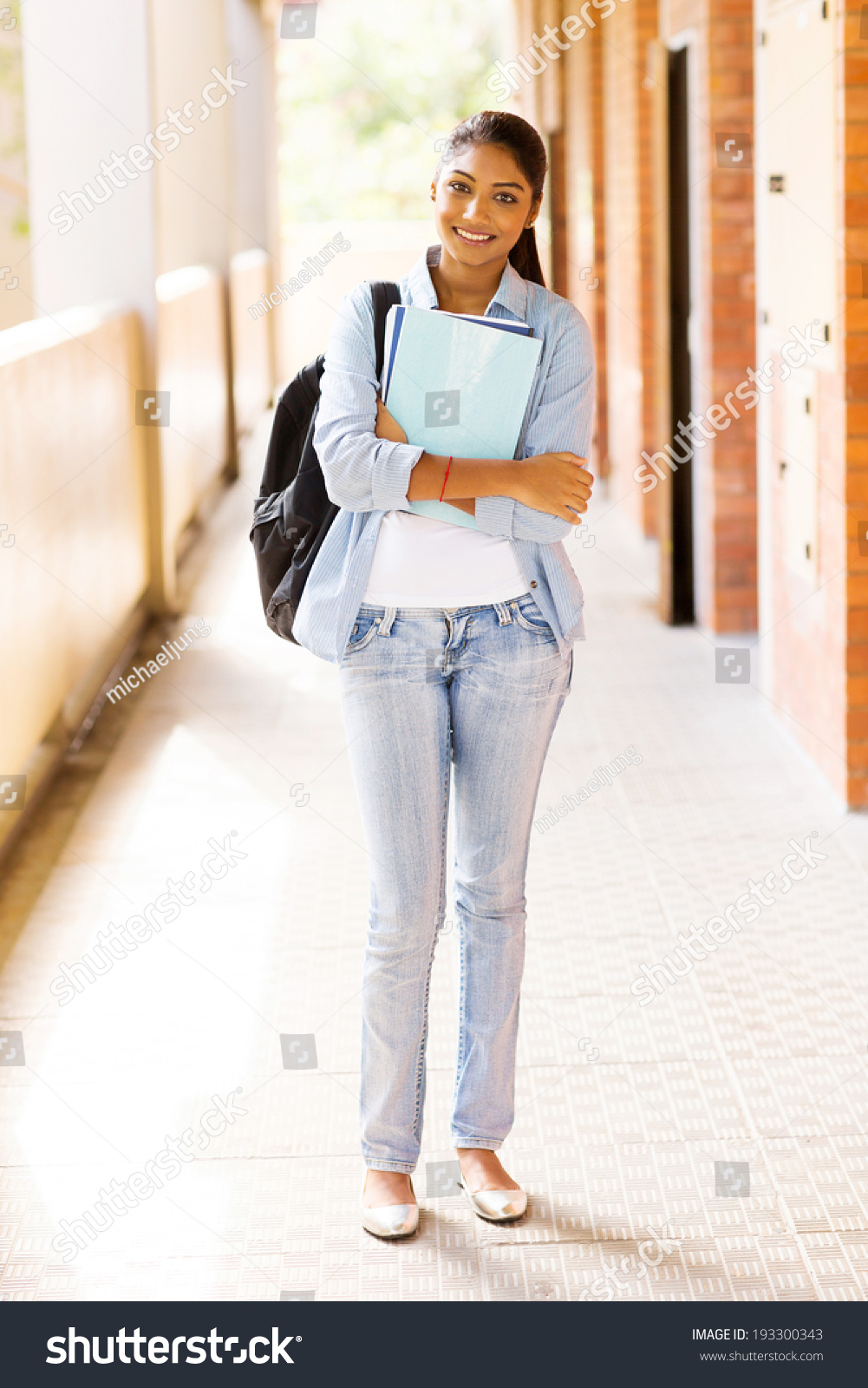 beautiful indian college girl holding books stock photo (edit now