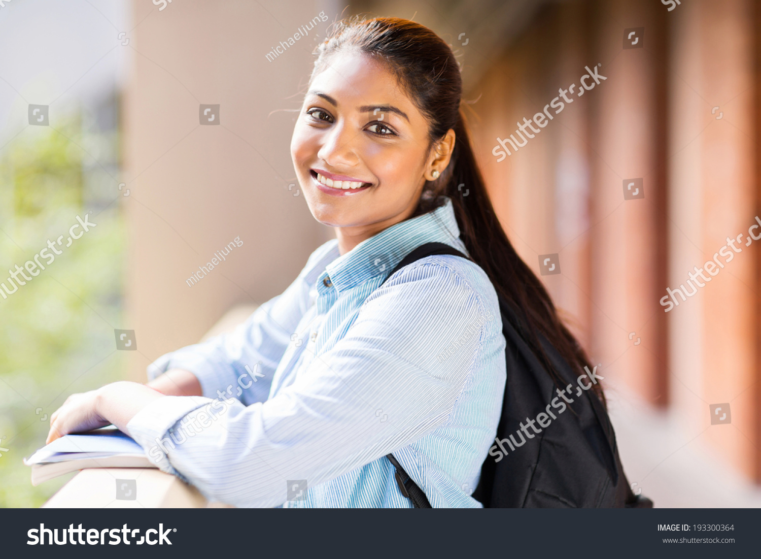 cute indian college girl standingstock photo (edit now