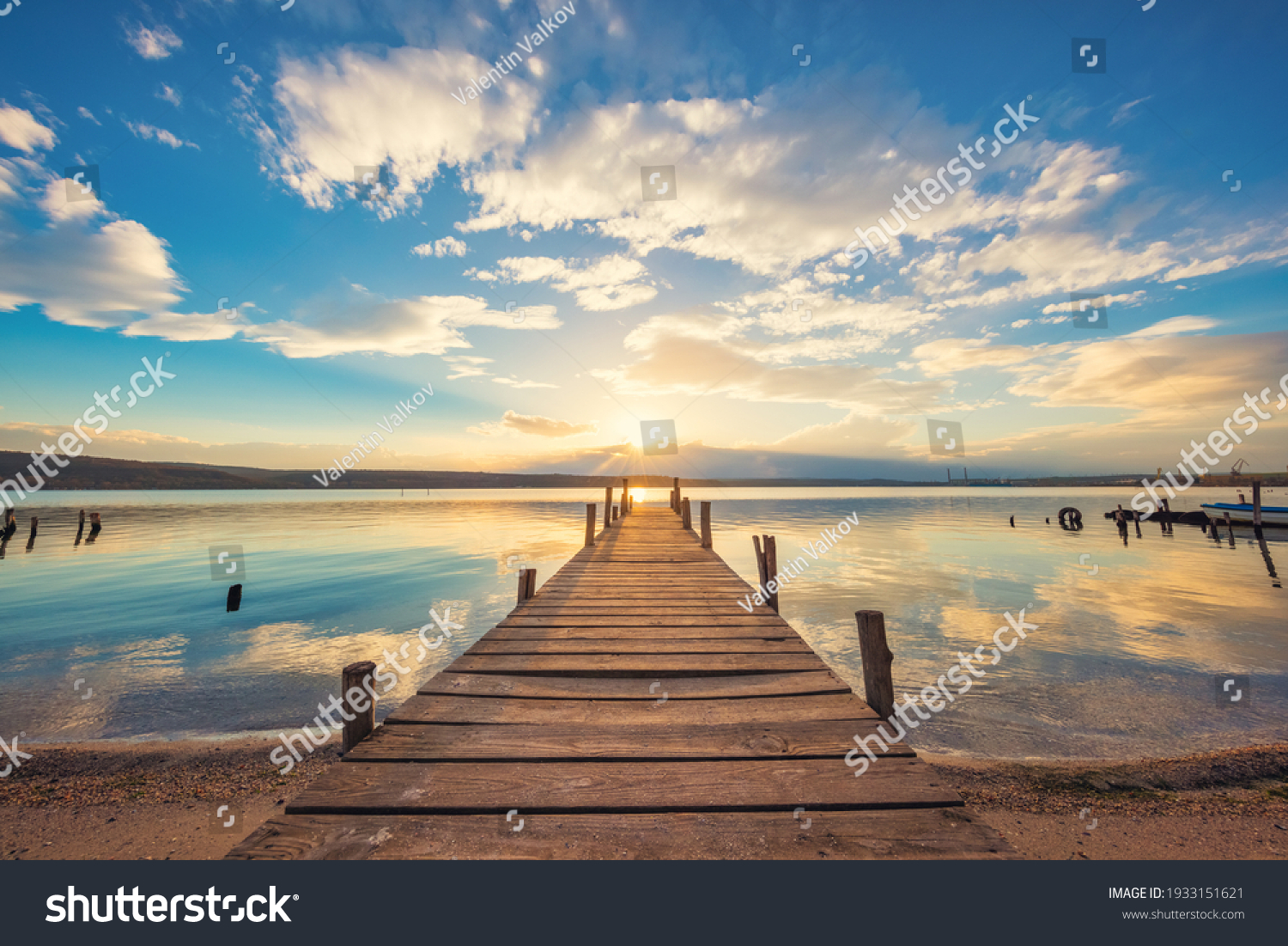 Old wooden dock at the lake, sunset shot #1933151621