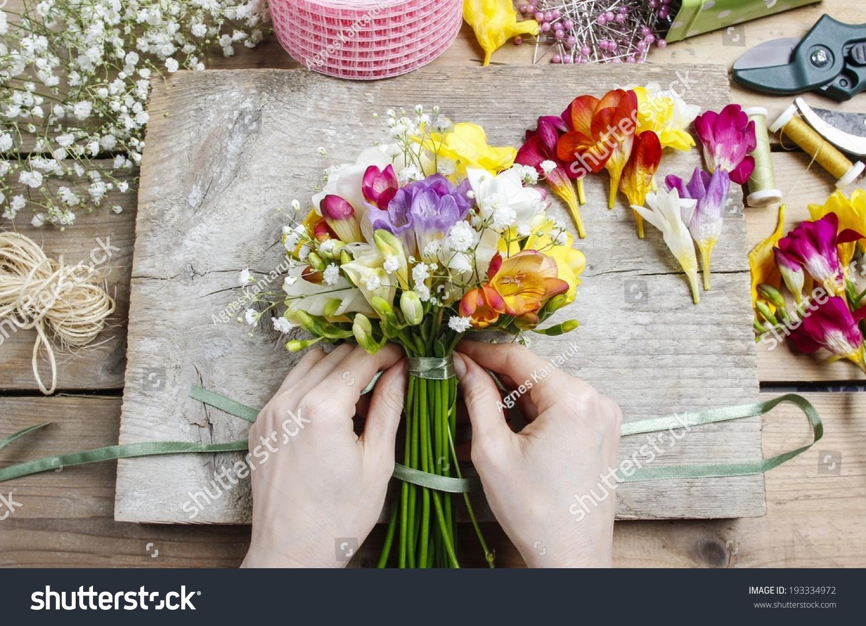 Florist work woman making bouquet freesia stock photo edit now woman making bouquet of freesia flowers izmirmasajfo