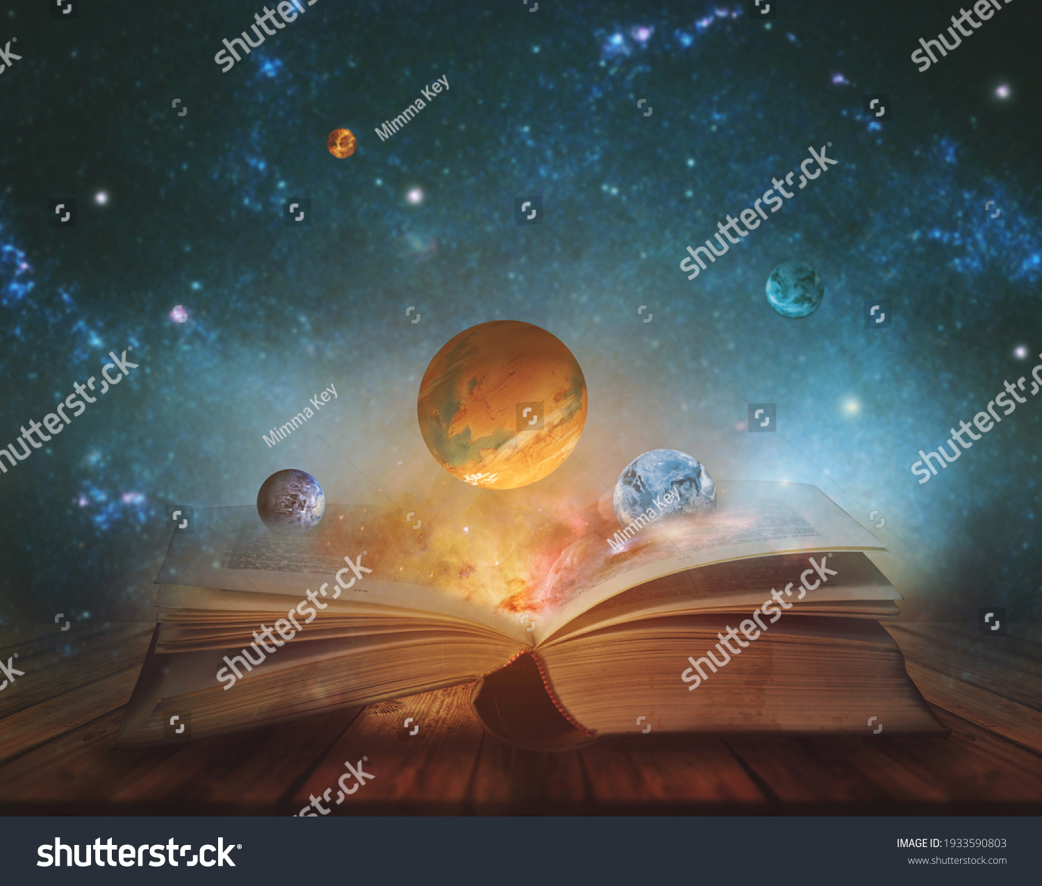 Book of the universe - opened magic book with planets and galaxies. Elements of this image furnished by NASA #1933590803