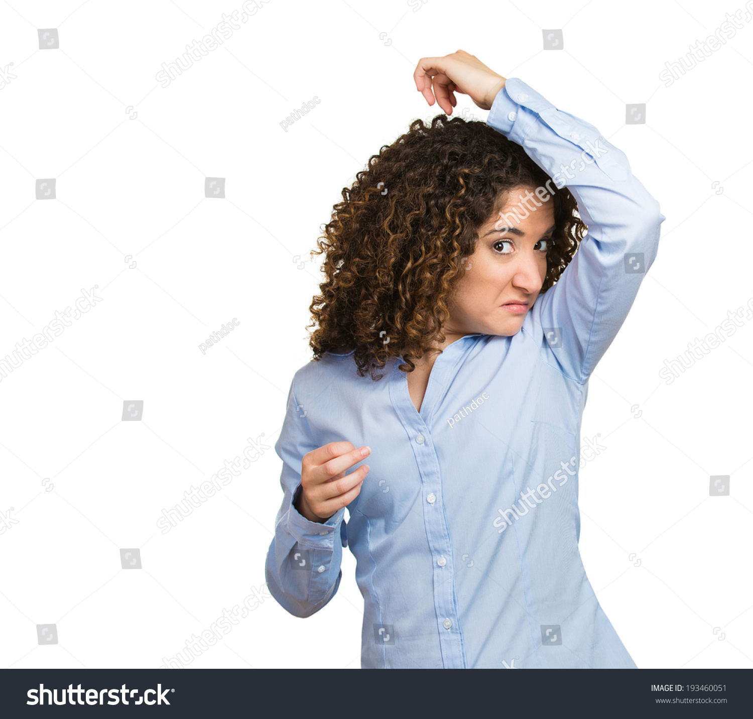 Closeup portrait young woman smelling sniffing her wet for How to get bad smell out of armpits in shirts