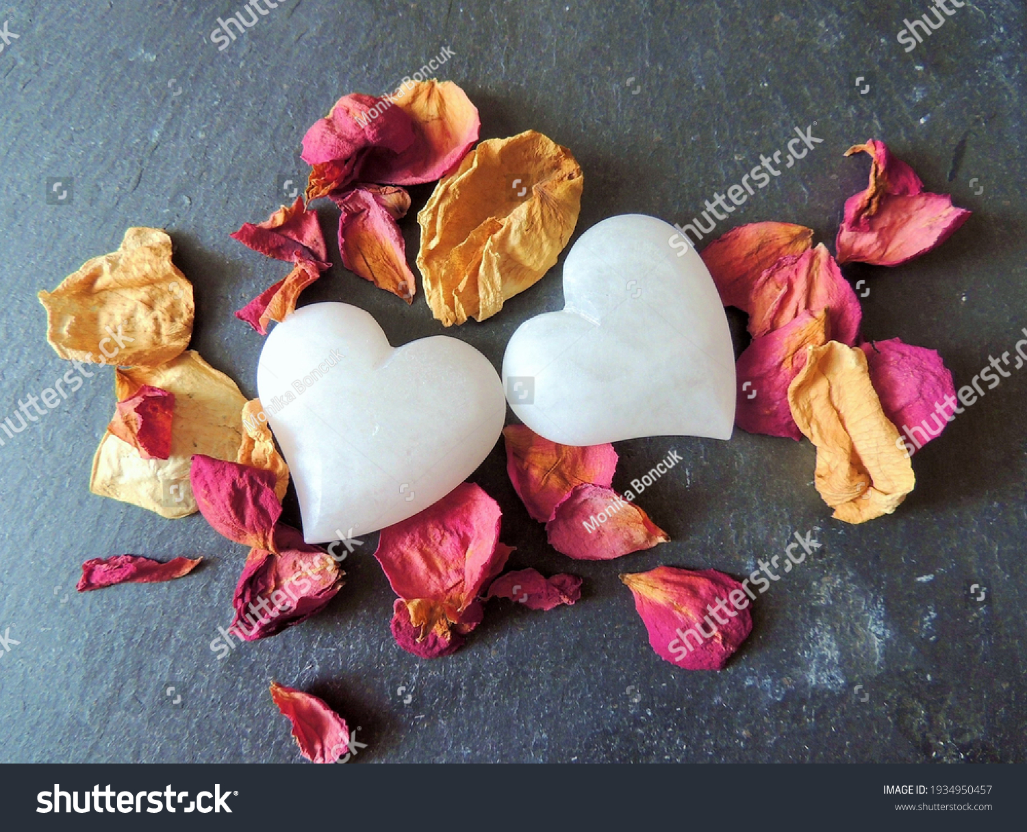stock-photo-two-hearts-and-dry-rose-peta