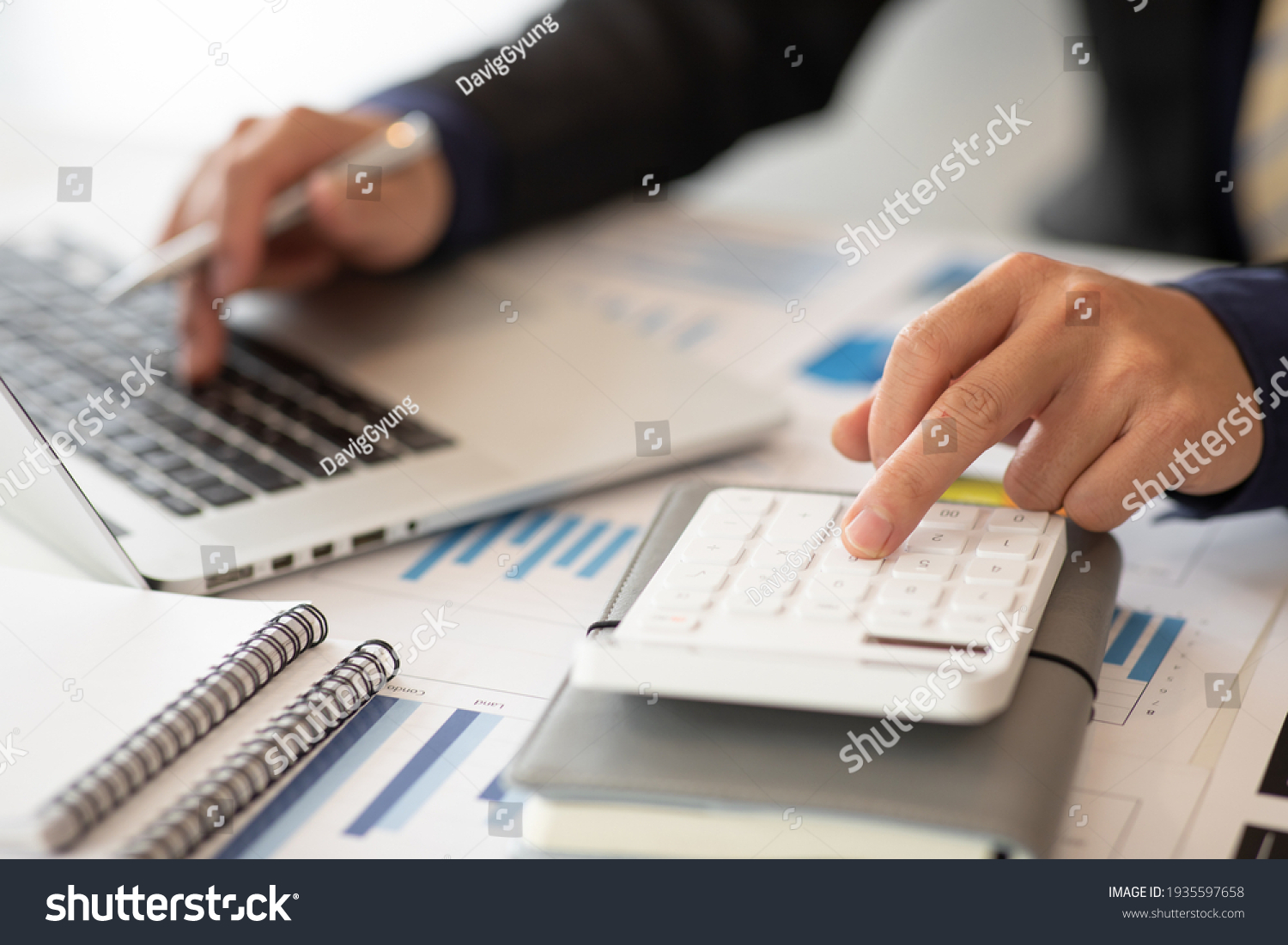 Businessmen are calculating income-expenditure and analyzing real estate investment data, Accounting Financial and tax systems concept. #1935597658