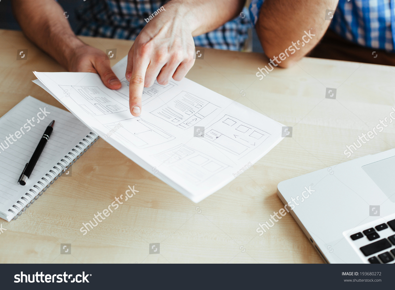 Closeup two men discussing website blueprint stock photo 193680272 close up of two men discussing a website blueprint malvernweather Image collections