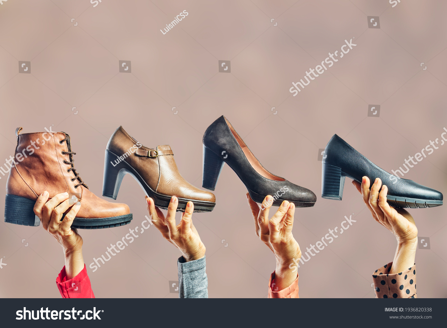 Hands holding different women shoes and boots. Concept of selection, purchase and repair of shoes #1936820338