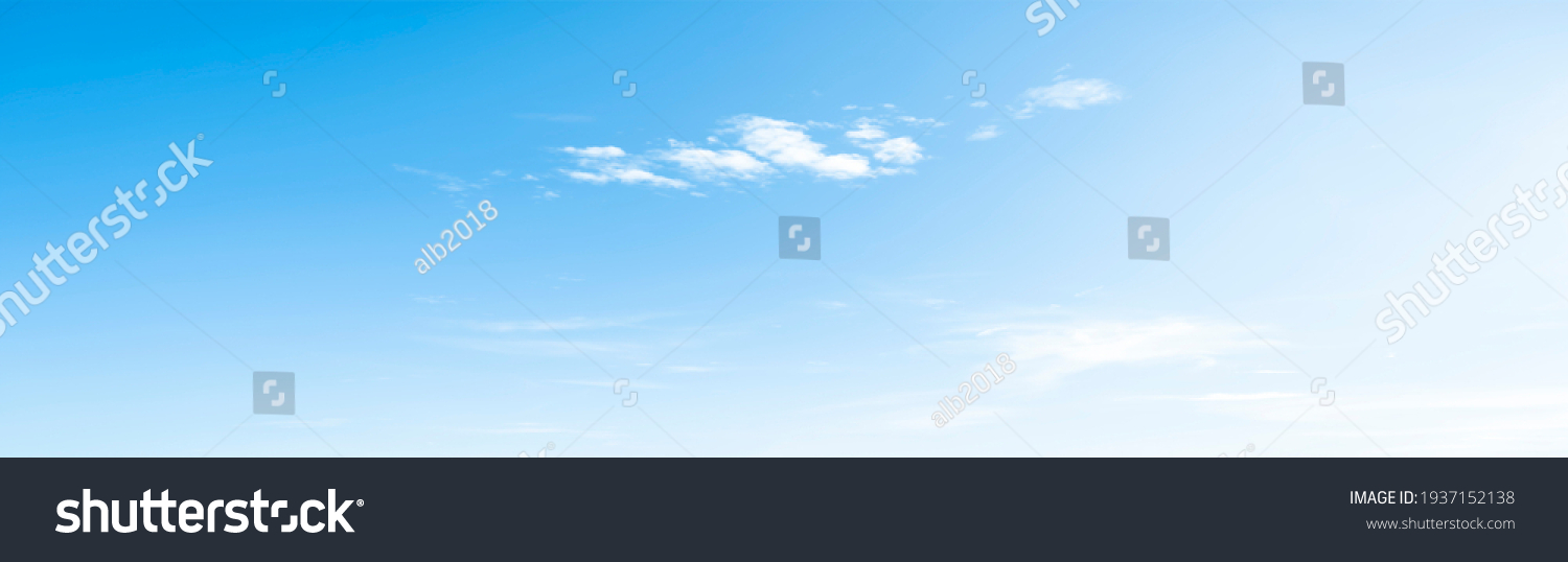 Blue sky and white clouds floated in the sky on a clear day with warm sunshine combined with cool breeze blowing against the body resulting in a miraculous refreshing like paradise. #1937152138