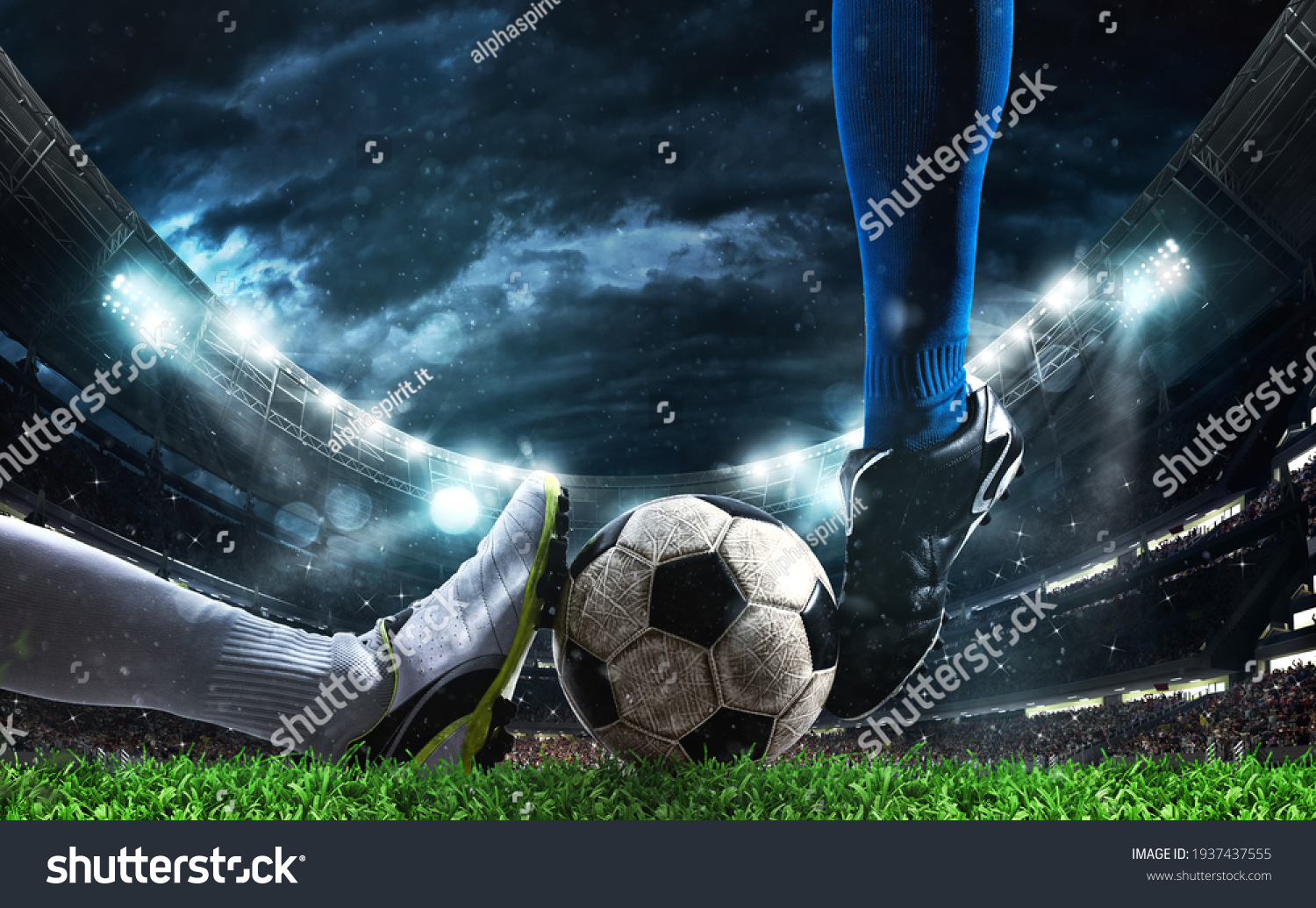 Close up of a football action scene with competing soccer players at the stadium #1937437555