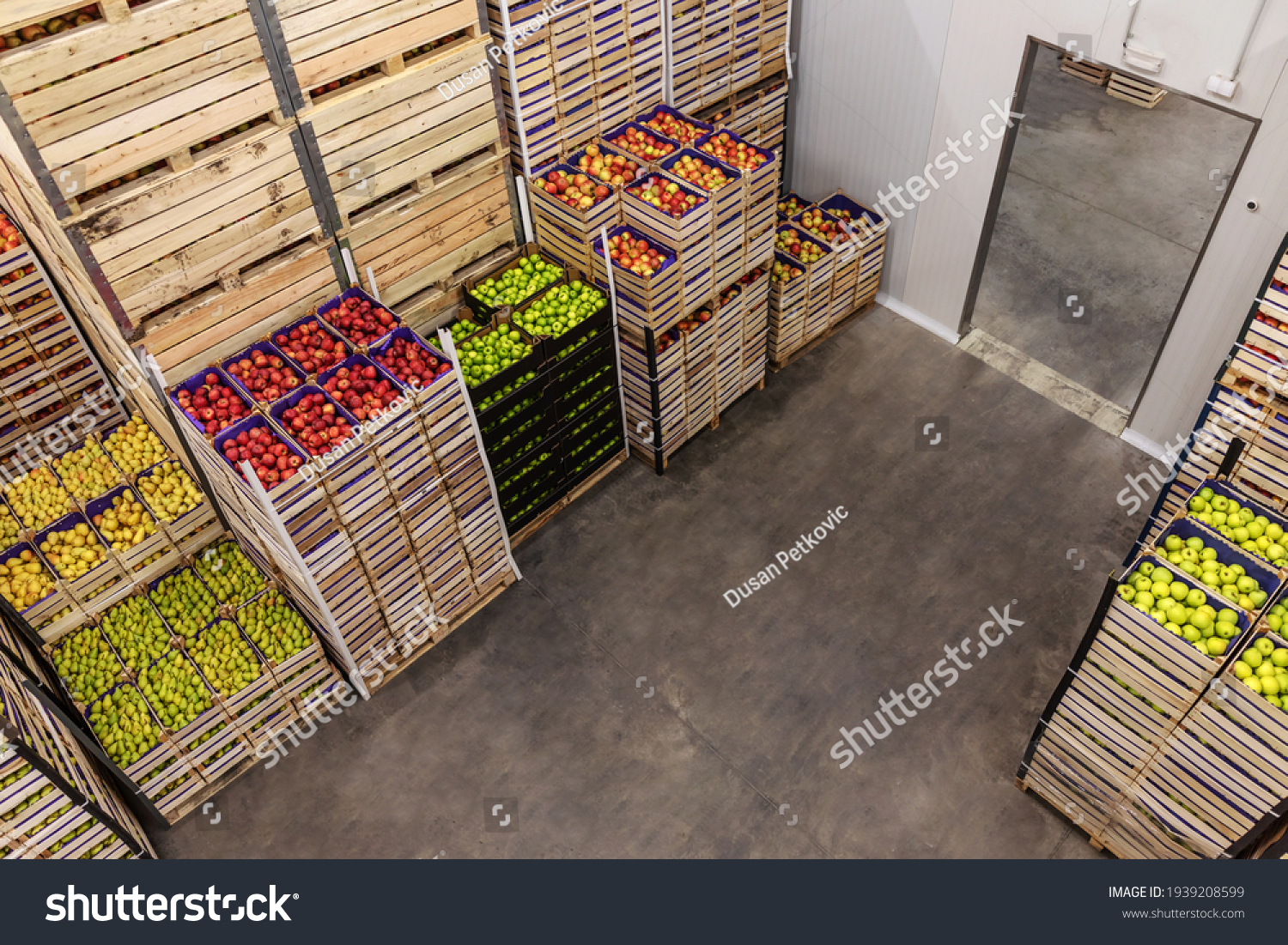 Apples and pears in crates ready for shipping. Cold storage interior. #1939208599