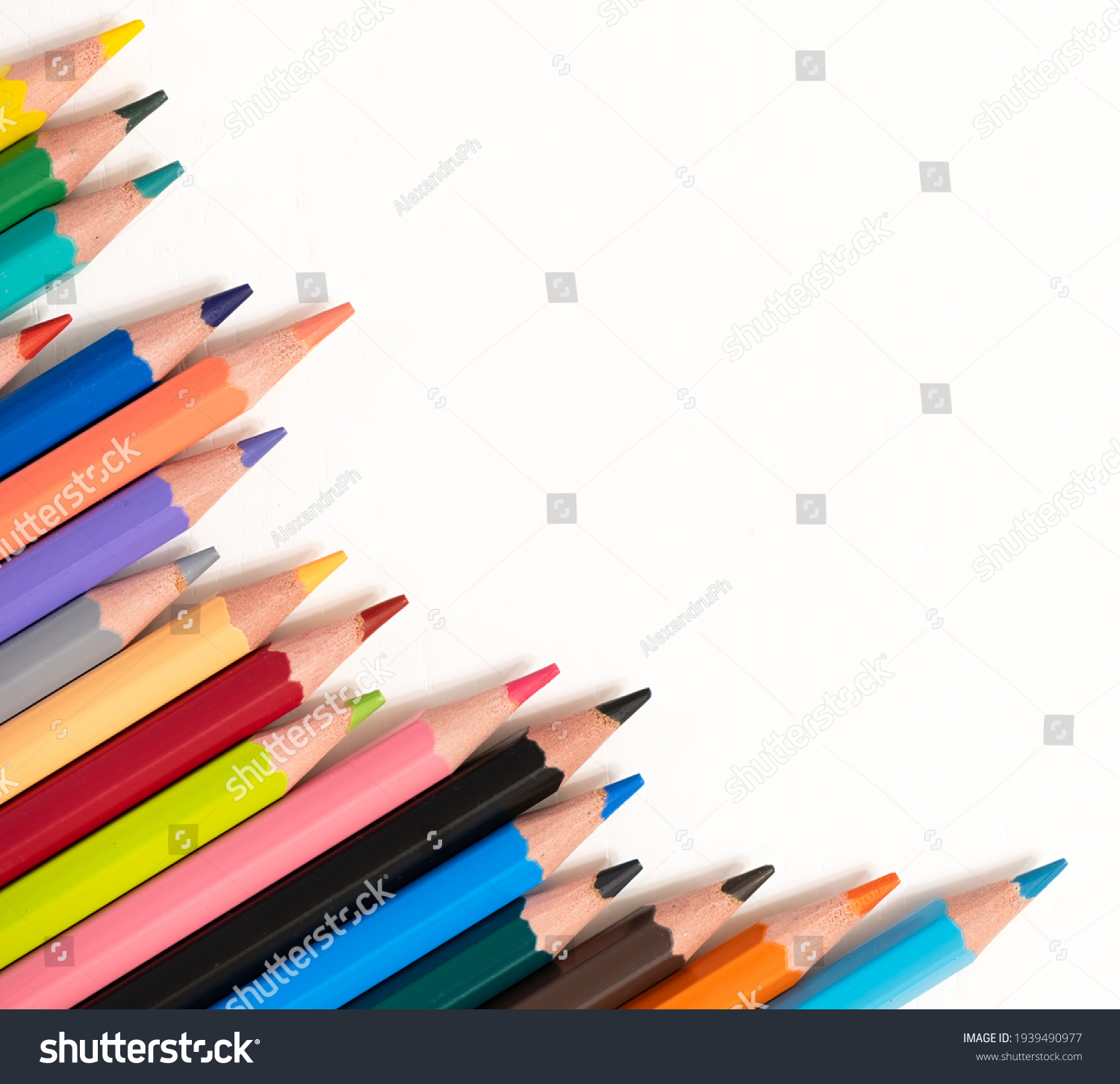 Color pencils on white background, top right view with space for text. Back to school concept copy space for text #1939490977