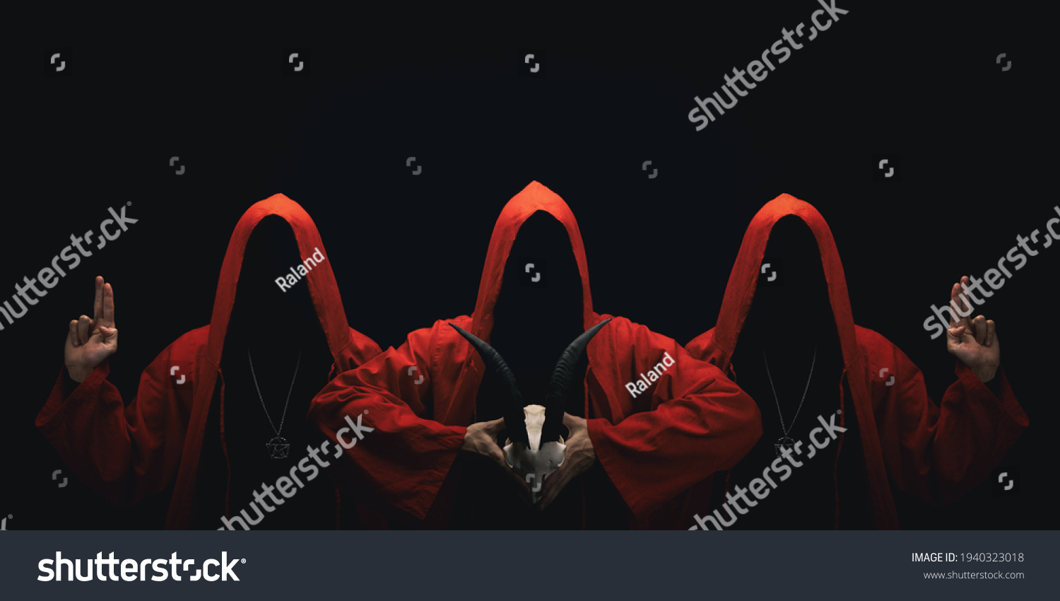Mystery people in a red hooded cloaks in the dark. Hiding face in shadow. Pointing up with fingers. Satanic symbols. Ghostly figure. #1940323018