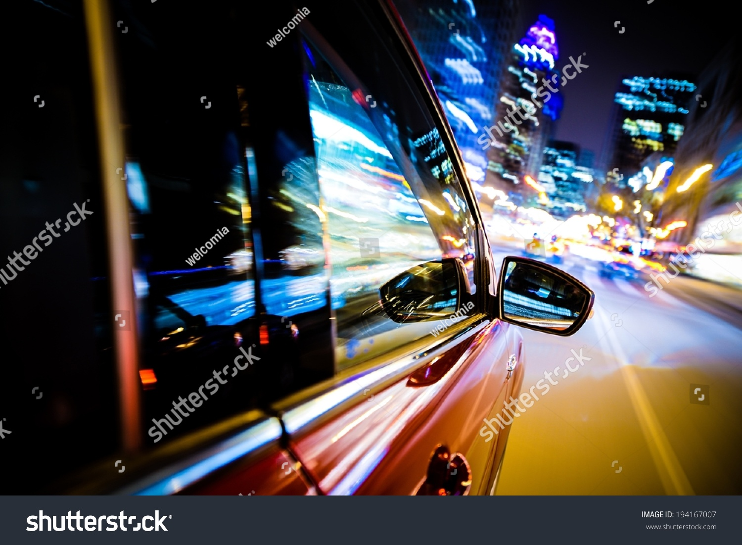 Driving Through City Lights. Car Side And Mirror View