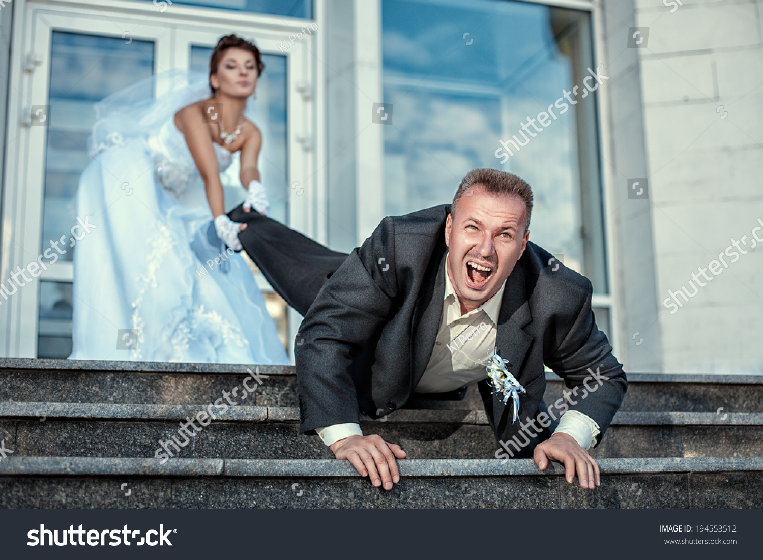 Bride Leg Pulls Groom Wedding Stock Photo (Safe to Use) 194553512 ...