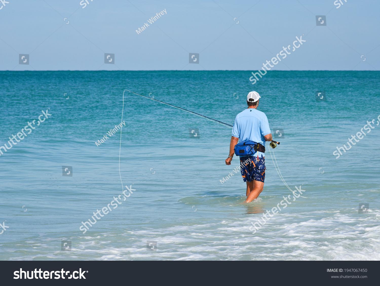 stock-photo-an-unidentified-man-wading-i