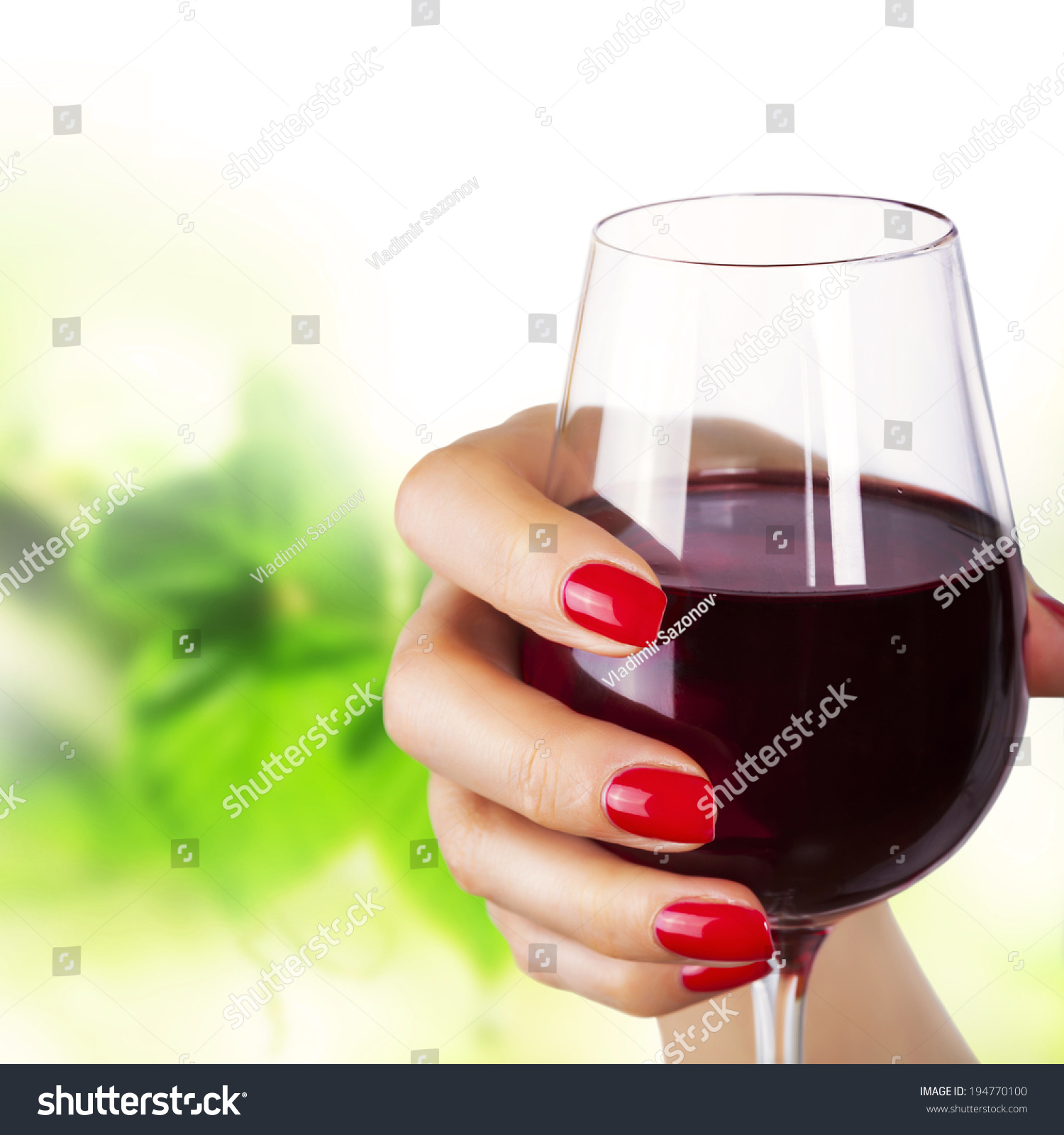 Woman Holding A Wine Glass. Stock Photo 194770100 ...