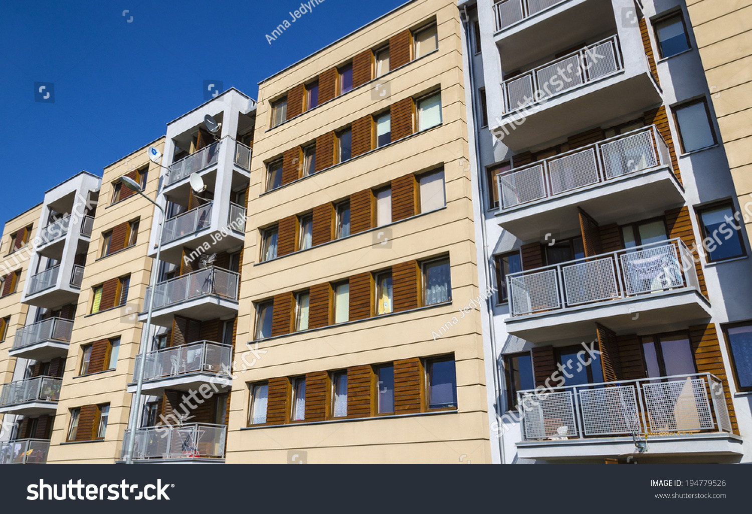 Architectural Background Of A Modern Stylish Apartment Building White Facade