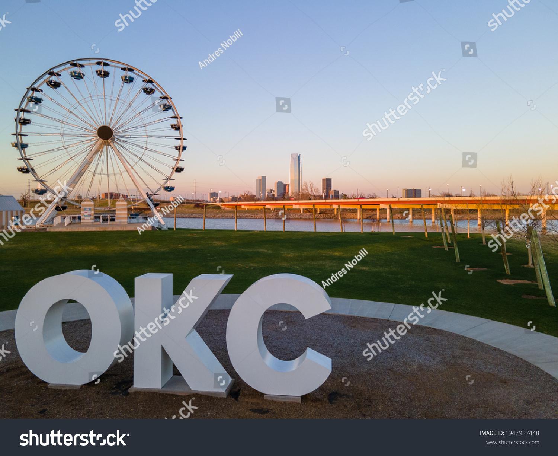 OKC sign and Wheeler Ferris Wheel with skyline  #1947927448