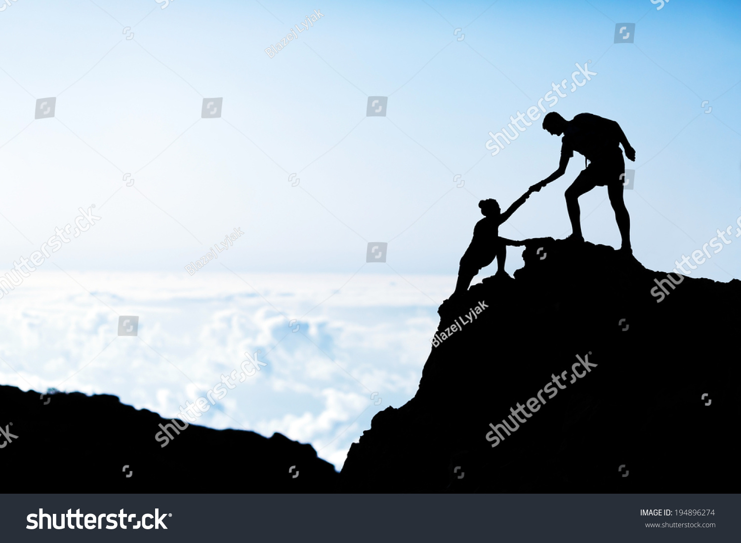 couple hiking teamwork partners help each stock photo  couple hiking teamwork partners help each other silhouette in mountains motivation and inspiration man