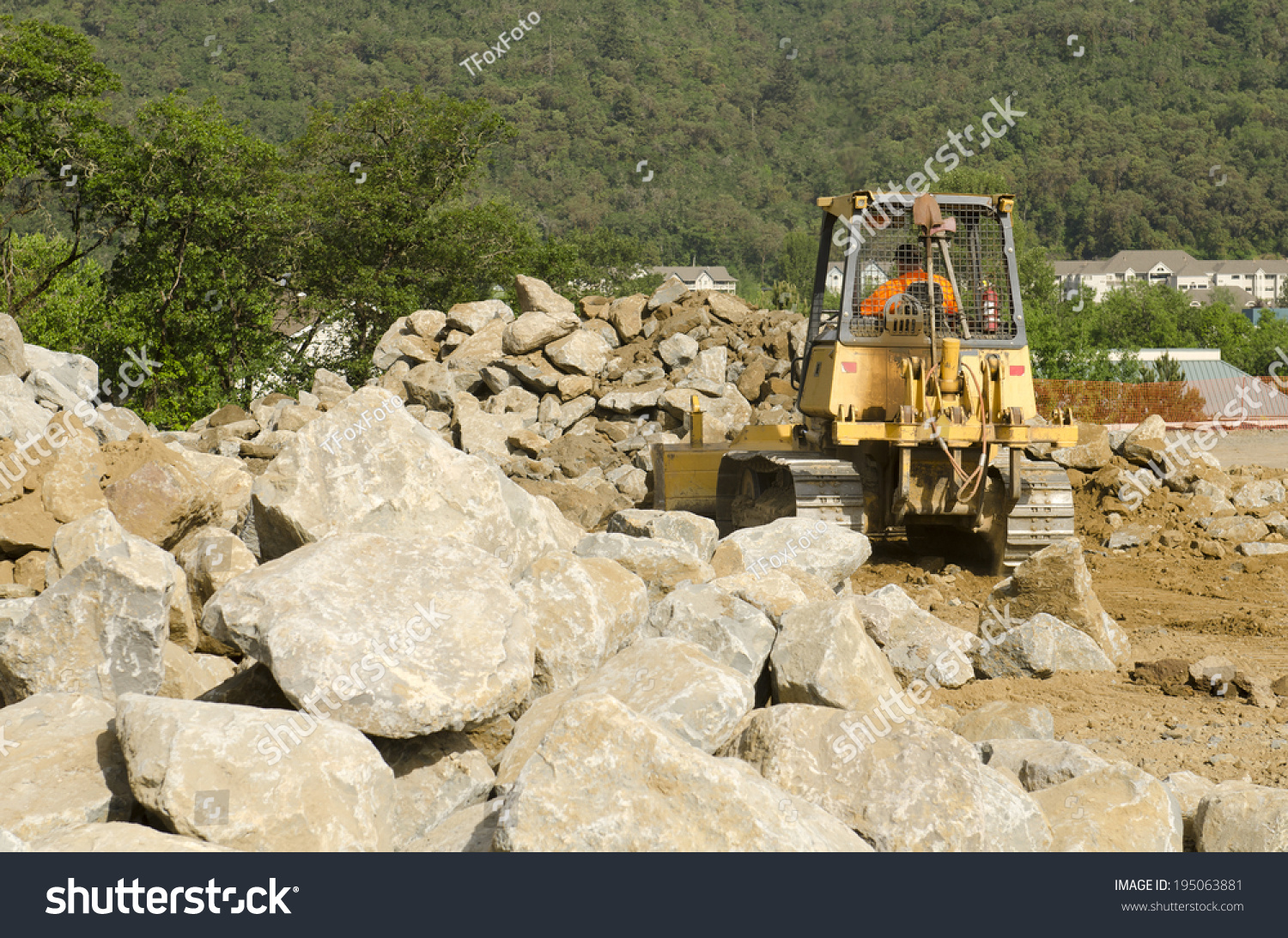 Dirt And Stone : Bulldozer spreads dirt rock new fill stock photo