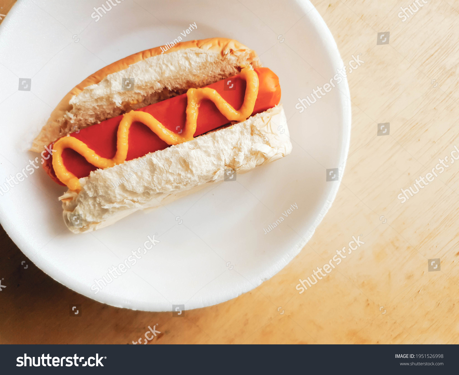 stock-photo-hot-dog-with-mustard-in-styr