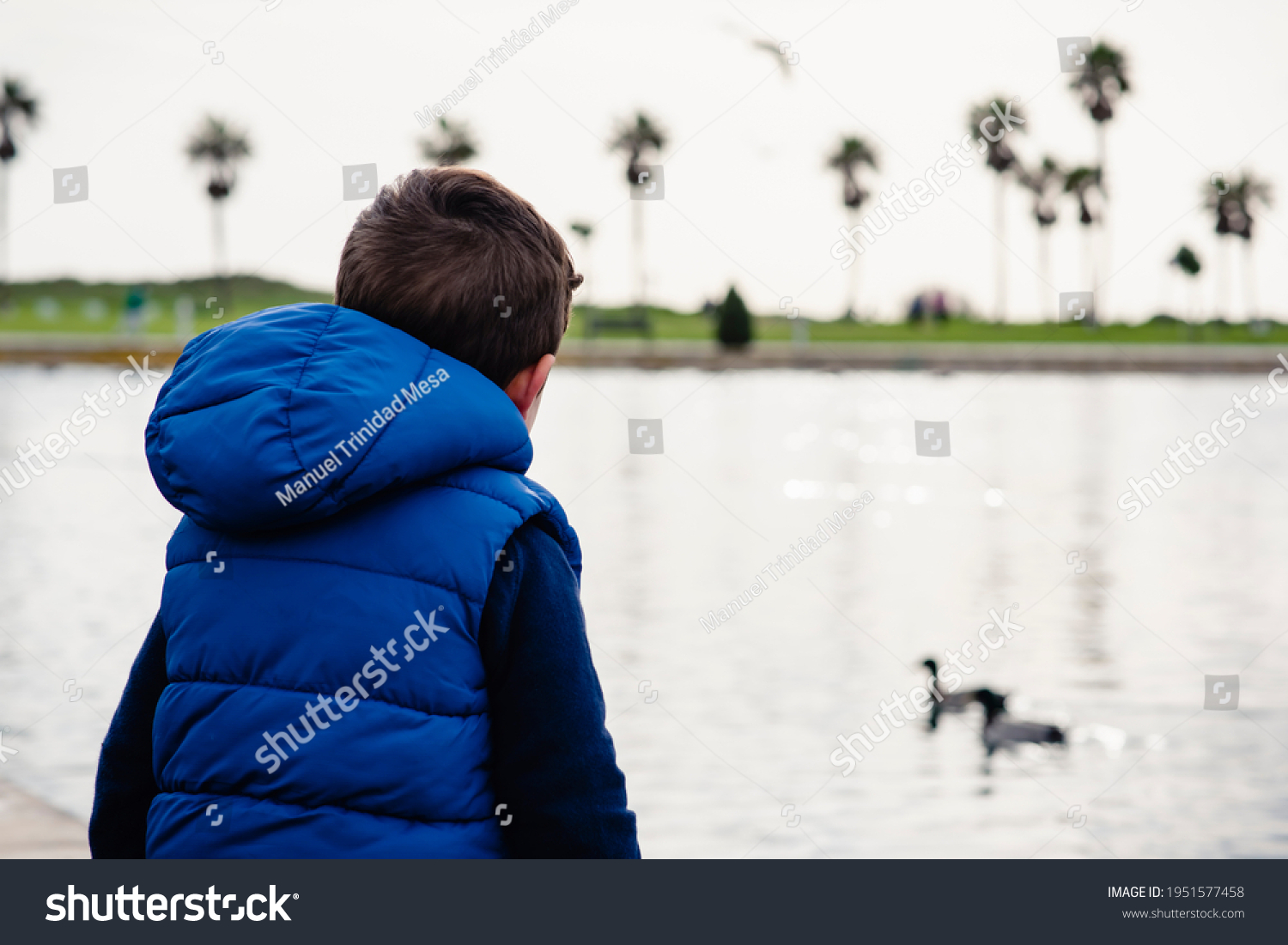 stock-photo-boy-on-his-back-watch-the-du