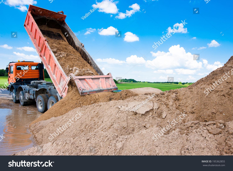 Construction Site Soil : Dumper truck unloading soil or sand at construction site