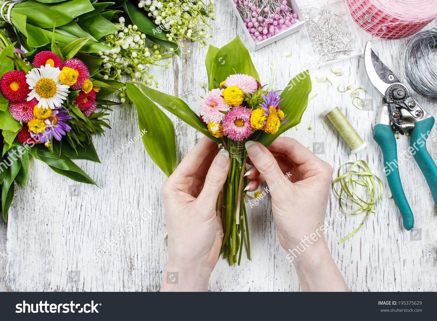 Florist at work woman making bouquet of wild flowers ez canvas id 195375629 izmirmasajfo