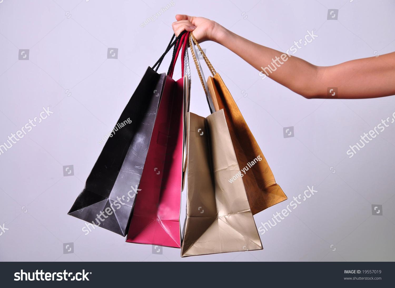 woman hand carrying bunch shopping bags stock photo 19557019